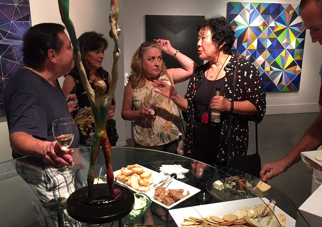 Artist Chun Hui Pak discusses her art over refreshments