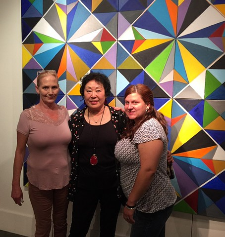 Artist Chun Hui Pak with gallery visitors interested in her Morning Glory artwork