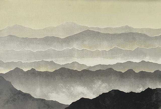 mountain range, mist rising in foreground, muted tones