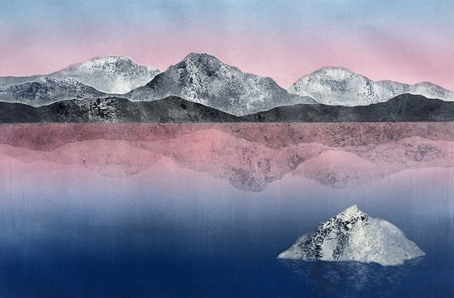 Mountains reflected in lake, pink sky