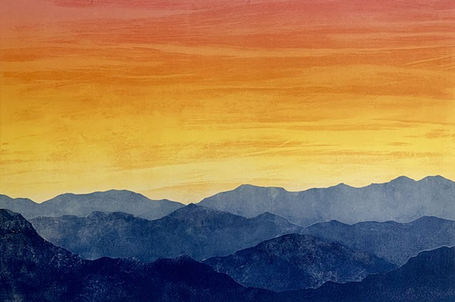 Blue mountain range, sunset sky