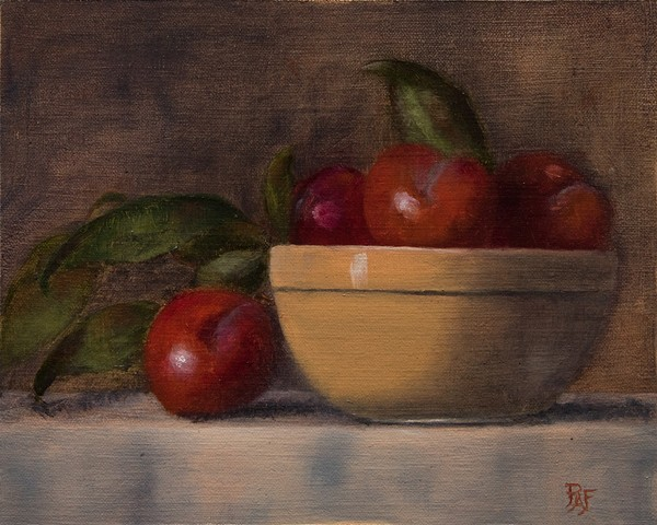 Plums in ceramic bowl