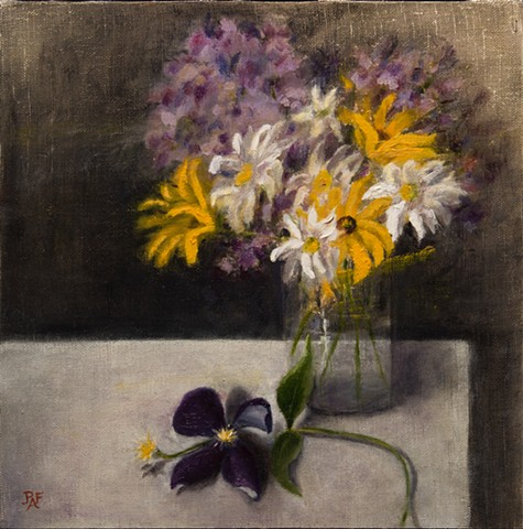 Clematis and flowers in glass vase