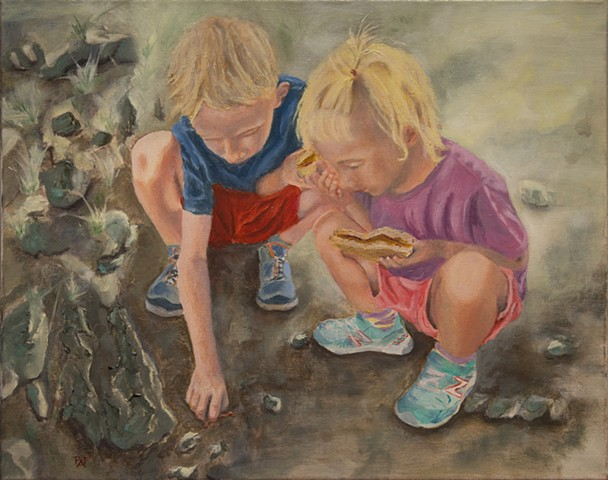 Two kids looking at a bug
