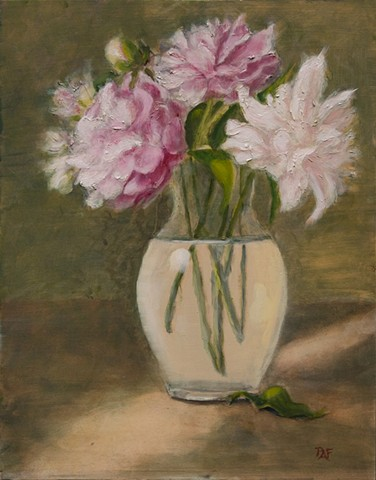 Pink and white peony's in glass vase