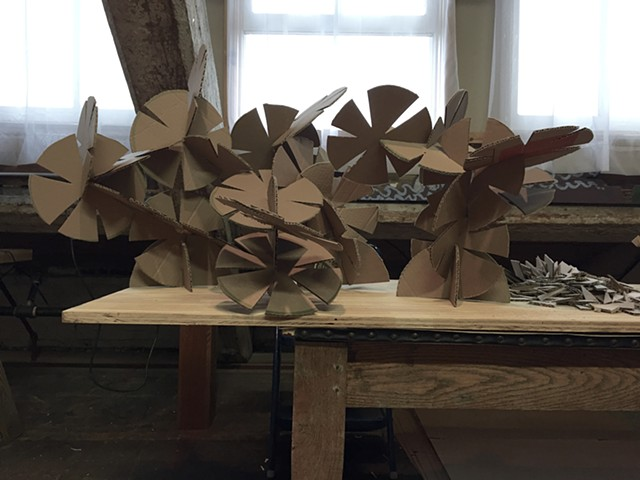 "Sculpture made with ""cardboard interlockers""."
