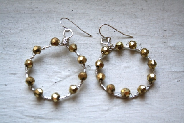 delicate silver hoops studded with sparkly, faceted beads.