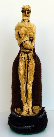 Oscar academy award wine bottle cozy crochet wine cozy yarn fiber art by Pat Ahern.