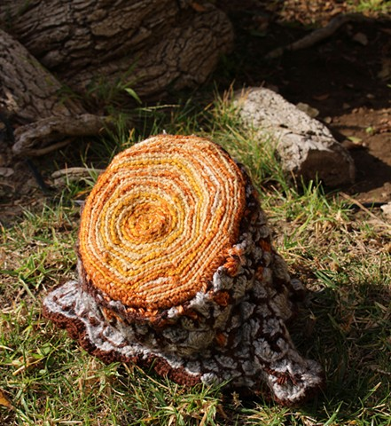 Stump log toilet paper cozy crochet tp cozy yarn fiber art by Pat Ahern.