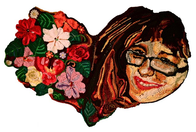 Crochet art portrait of a woman crochet flowers heart crochet fiber art by Pat Ahern.