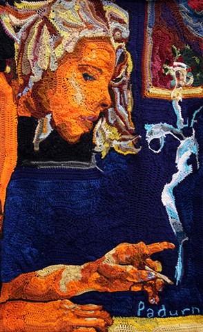 Crochet art portrait of a woman smoking in a cafe ashing cigarette crochet fiber art by Pat Ahern.
