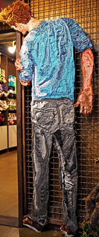 Crochet art portrait of a man peeking around a corner at Gather DTLA inside The Last Bookstore Downtown L.A. crochet fiber art by Pat Ahern