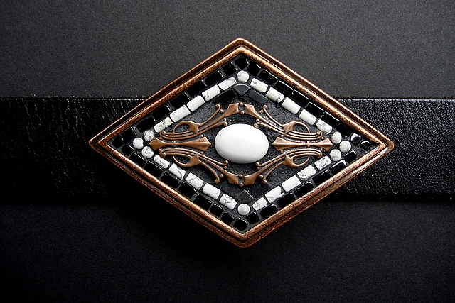 One of a kind belt buckle with magnesite, copper, onyx,howlite and hematite.