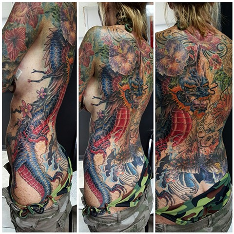 dragon tattoo. flower tattoo. koi tattoo. backpiece color tattoo