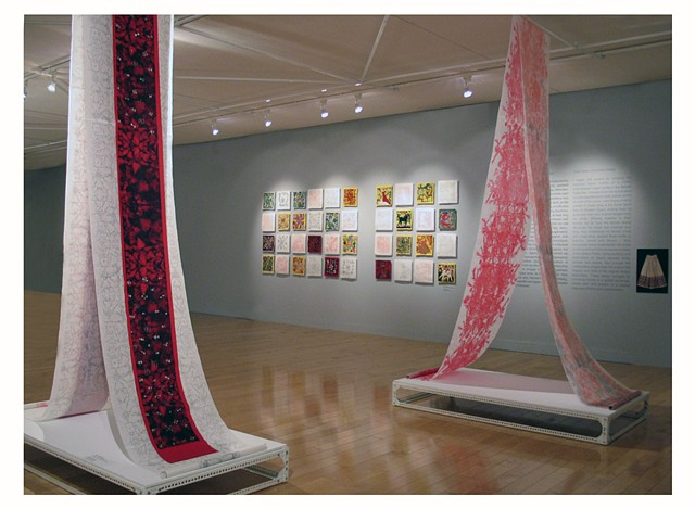 scroll installed at the Benaki Museum with images of red carnations