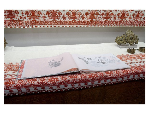 a handmade book with images of carnations