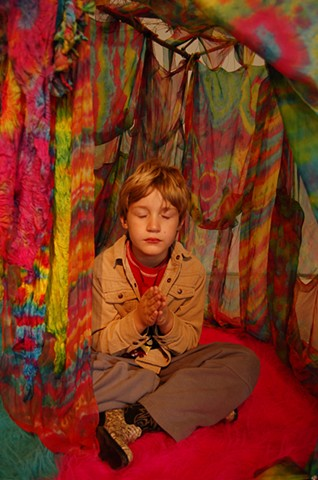 Technicolor Tents; boy meditating