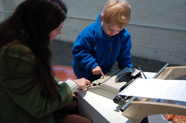 Typewriter; mother and toddler