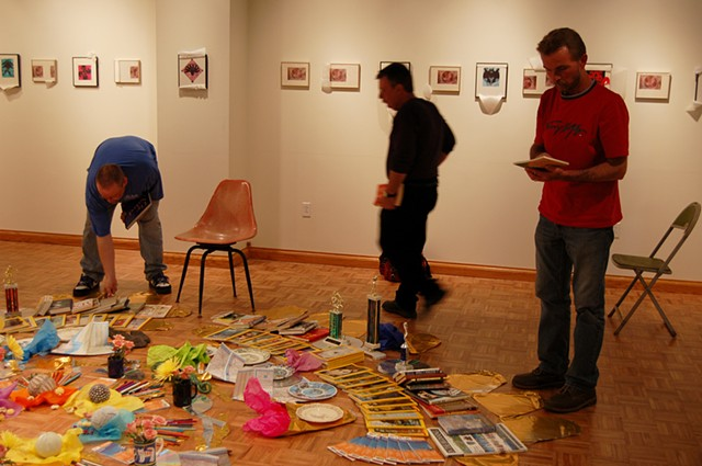 Mandala of Impermanence; opening, students perusing and choosing items from the installation