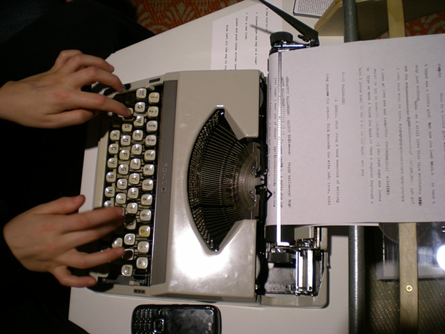 Typewriter; Kate's hands