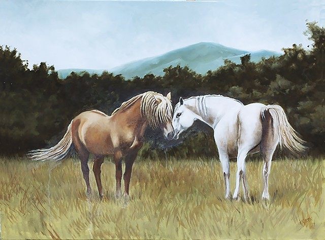 Palamino stallion and grey mare.