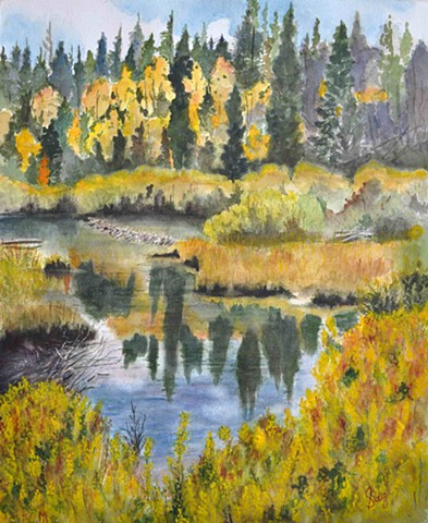 Pond and yellow aspens in Rocky Mountain