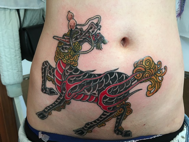 Kirin tattoo covering scar