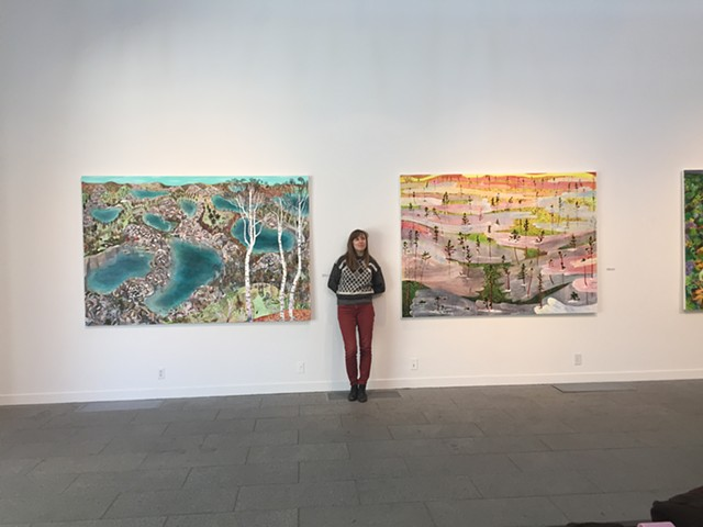 Rita between two paintings at Saint John's University. Collegeville, Minnesota. 2018