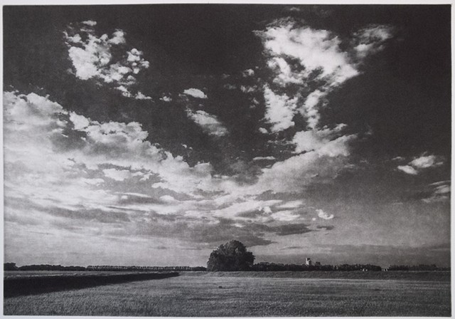June sunset on the prairie outside McCanna, North Dakota. A polymer photogravure image on pescia paper.