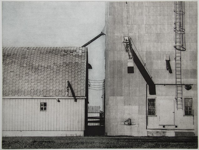 Grain elevators at railroad siding in North Dakota. One-plate polymer photogravure print on pescia paper by John Pearson.