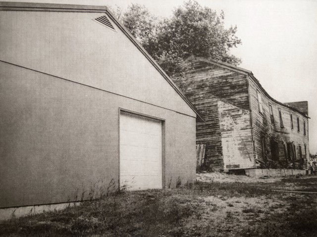 A new pole barn next to a dilapidated frame building in Niagara, North Dakota. One-plate polymer photogravure print on pescia paper by John Pearson.