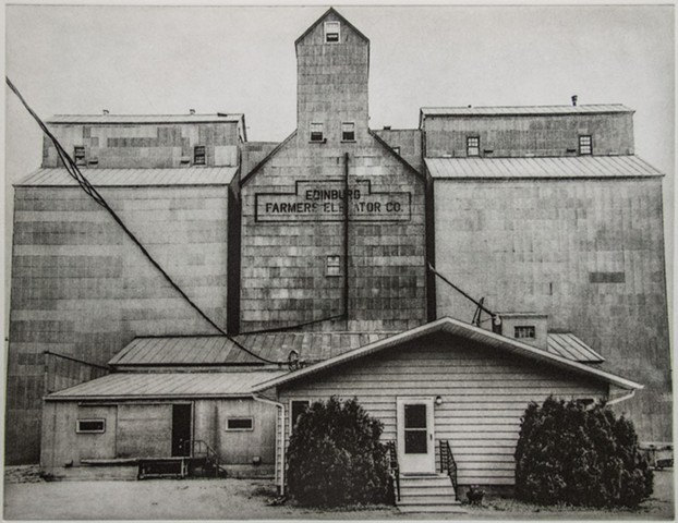 Elevator rising behind an office/home in Edinburg, North Dakota. One-plate polymer photogravure print on pescia paper by John Pearson.