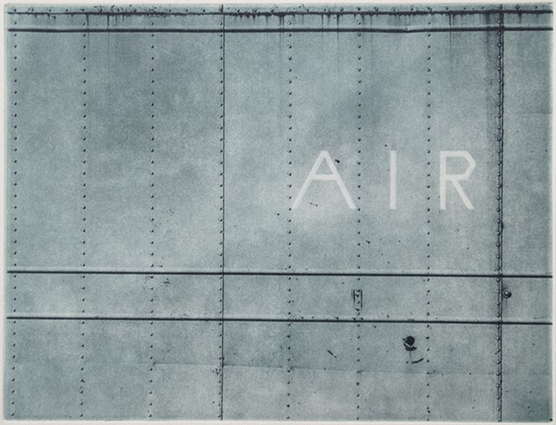 The word AIR on the side of a large metal container in western North Dakota