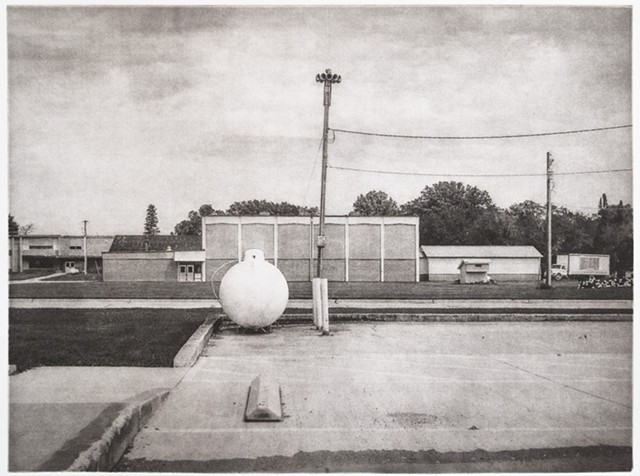 A natural gas tank and a civil defense siren in a small town in the Red River Valley of the North. One-plate polymer photogravure print on pescia paper by John Pearson.
