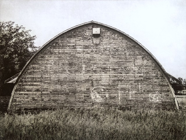 North Dakota barn carrying graffiti symbols: swastika, yin-yan, and pentangle. One-plate polymer photogravure print on pescia paper by John Pearson.