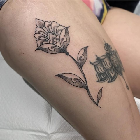 Amy Unalome. La Flor Sagrada Tattoo, Melbourne. Ornamental flower tattoo on thigh.