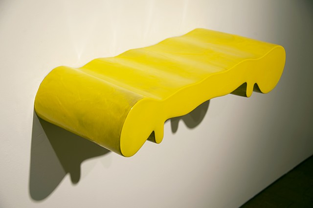 biomorphic ceramic sculpture in yellow by artist Jeff Krueger
