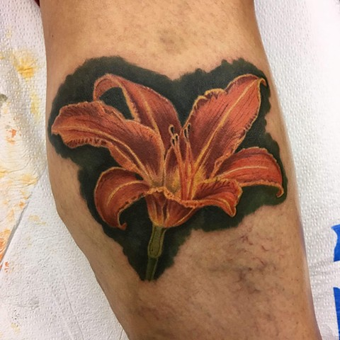 day lily apprentice tattoo.