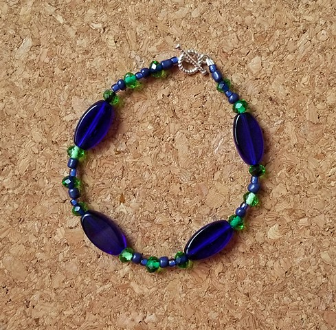 multi-strand bracelets in dark blues and greens with silver toggle clasp by Holly Campbell