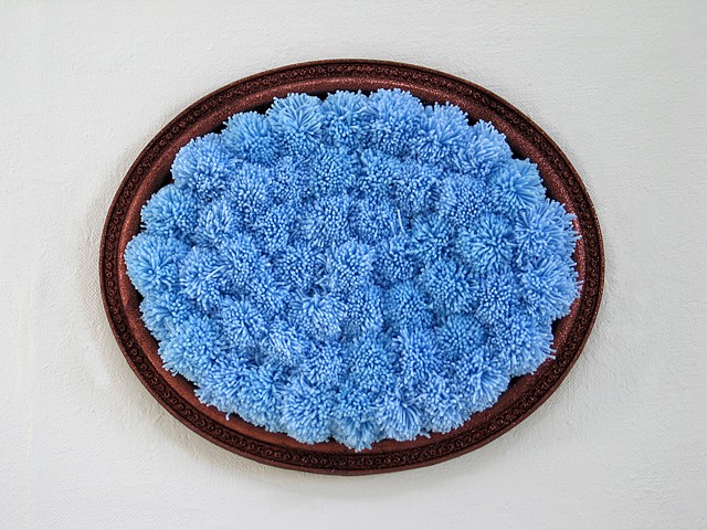 sculpture found oval picture frame painted glitter brown with sky blue yarn pom poms by Holly Campbell