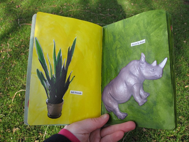 2012 sketchbook project snake plant still friends photograph on yellow page rhino on green page by Holly Campbell