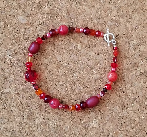 bracelet red aber resin dyed quartzite glass seed with sterling silver plated toggle clasp by Holly Campbell