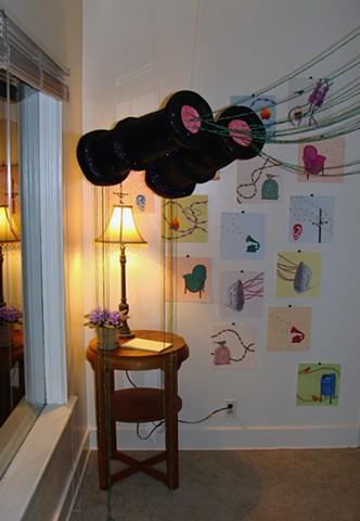 sculpture installation parlor room gallery binoculars green strung beads drawings chair camp fires irons mailboxes radios by Holly Campbell