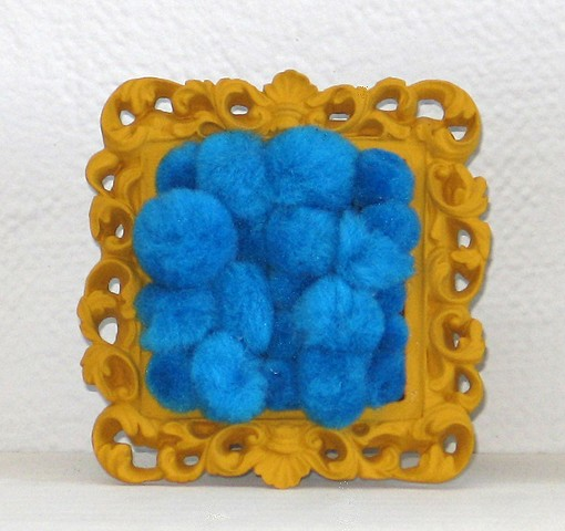 found picture frame sculptures painted filled with turquoise gold pom poms by Holly Campbell