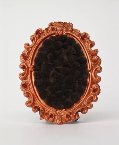 found picture frame sculptures painted pearly orange filled with brown colored pom poms by Holly Campbell