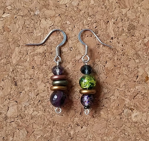 earrings made with Saturn's rings, glass, amethyst, and stainless steel ear hooks