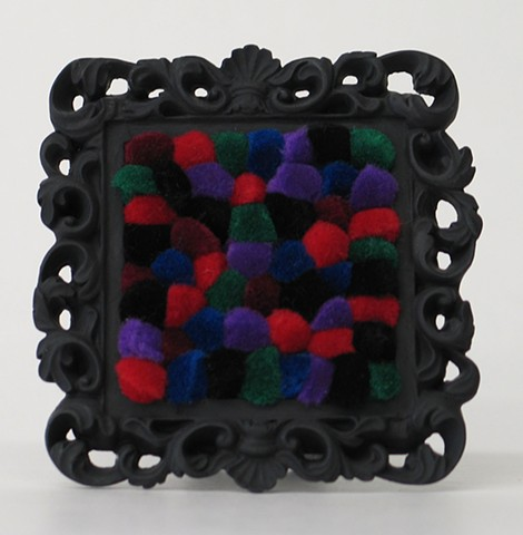 sculpture found picture frames painted black with jewel tone pom poms by Holly Campbell