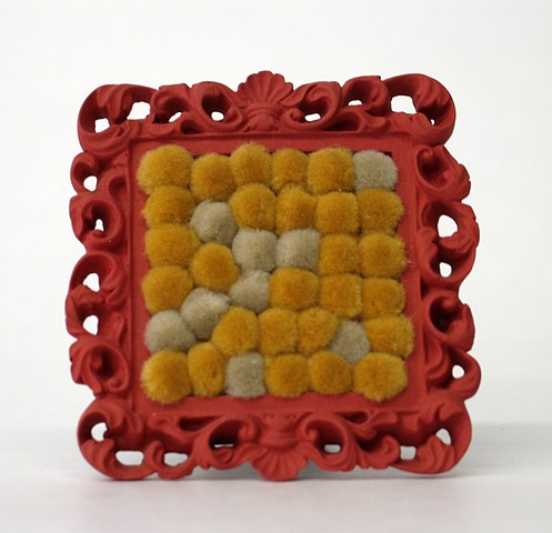sculpture found picture frames painted salmon color with gold tan pom poms by Holly Campbell