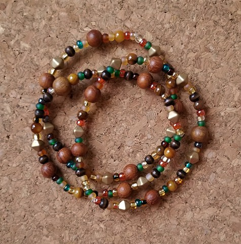 beaded bracelets with seed wood beads in earth tones with stretch cord by Holly Campbell