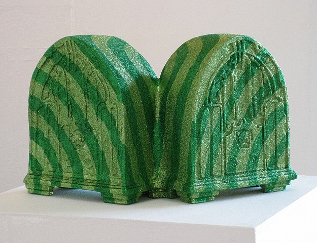 terra cotta low fire ceramic sculpture of conjoined early twentieth century radios covered in green glitter stripes by holly Campbell